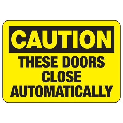 Caution Doors Close Automatically Sign