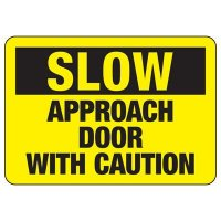 Slow Approach Door With Caution Sign