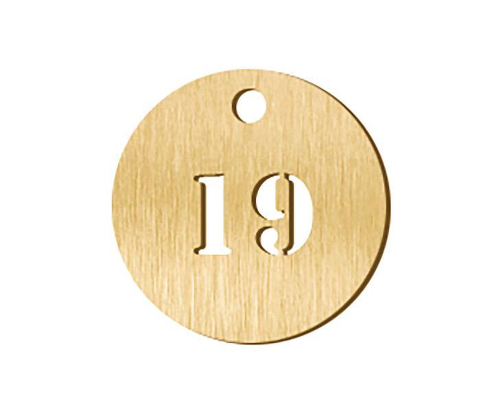 Jetons numérotés en métal ajouré (photo)