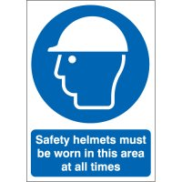 Plastic and vinyl signs with 'safety helmets must be worn in this area' message