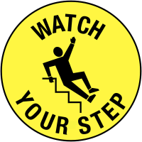 Circular, self-adhesive 'watch your step' floor markers