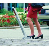 Semi-automatic pedal-operated drop down bollard
