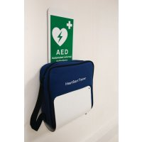 Wall-mounted defibrillator (AED) holder with sign