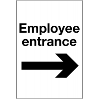 Easy-to-read reserved parking signs for the employee entrance with right-pointing arrow