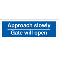 Car parking banner signs stating approach slowly, gate will open