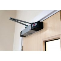 Wireless acoustic fire alarm door closer