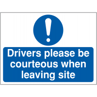 Building site signage informing drivers to be courteous