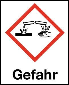 Symbol Ätzwirkung nach GHS mit Signalwort Gefahr