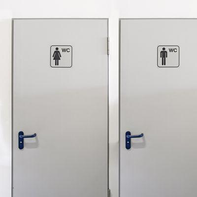 WC-Symbolschilder mit Damen- und Herren-Piktogramm