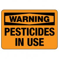 Warning Sign: Pesticides in Use