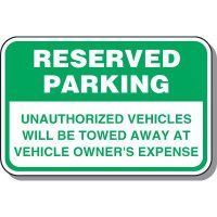 Reserved Parking Signs - Unauthorized Vehicles Will Be Towed