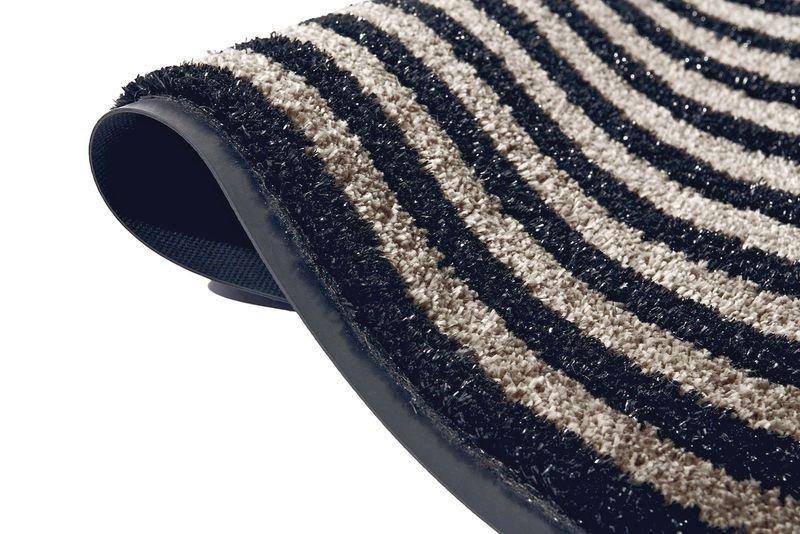 Tapis d'entrée à fibres grattantes