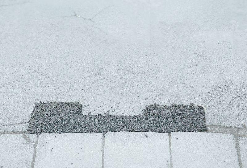 Koudasfalt voor schade aan wegdek, voetpaden of parkings