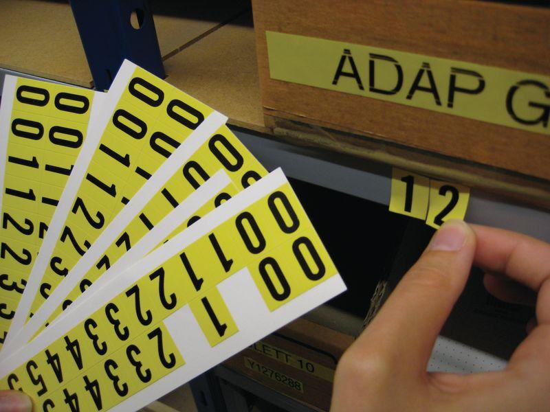 Cijfers en letters van geplastificeerde stof, complete reeksen