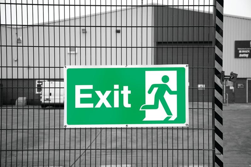 Banner Signs - Exit Running Man Right - Seton