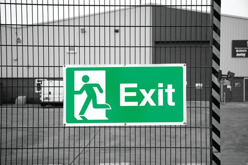 Banner Signs - Exit Running Man Left - Seton