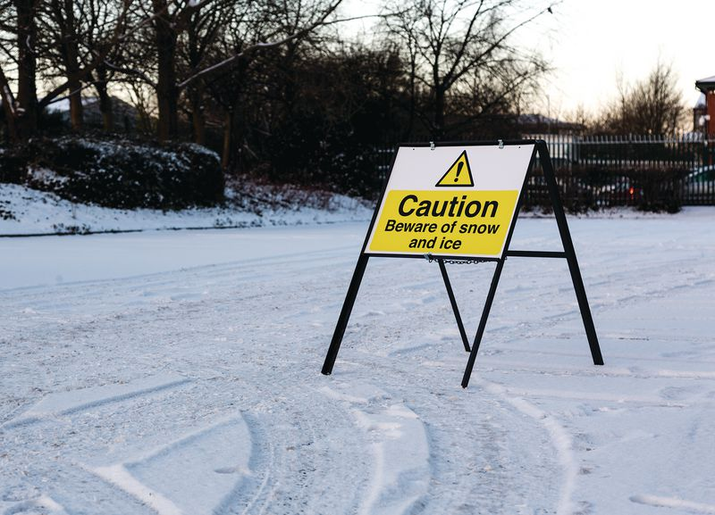 Caution Beware of Snow And Ice Stanchion Sign