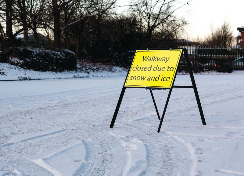 Walkway Closed Due To Snow And Ice Stanchion Sign