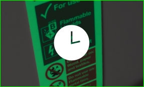 Glow in the dark fire equipment sign with a clock icon