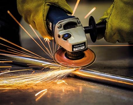 Aluminium Asset Tag on angle grinder