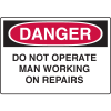 OSHA Danger Signs - Do Not Operate Man Working On Repairs